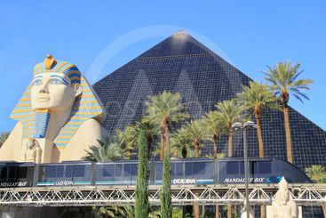Mandalay Bay tram in front of Luxor hotel and casino,...