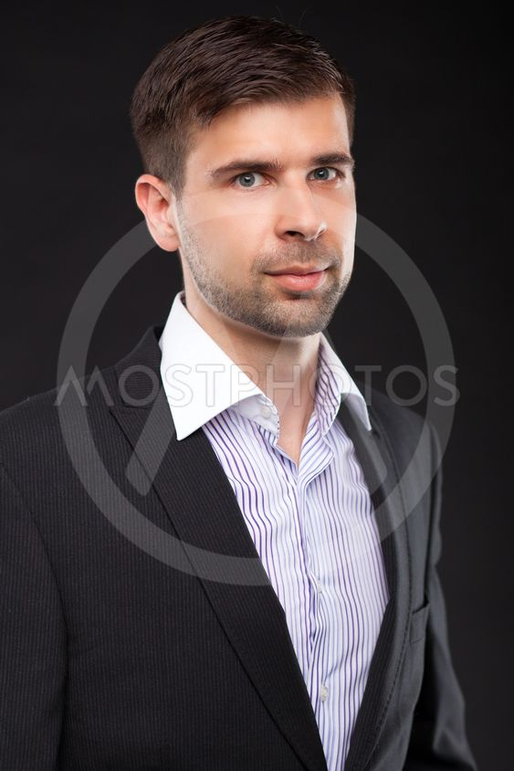 Young businessman in a black suit