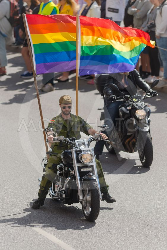 Motorbikes at the pride parade in Stockholm with happy...