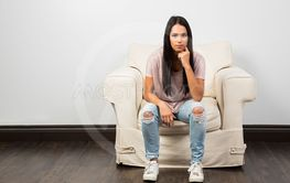 Sitting on a white couch