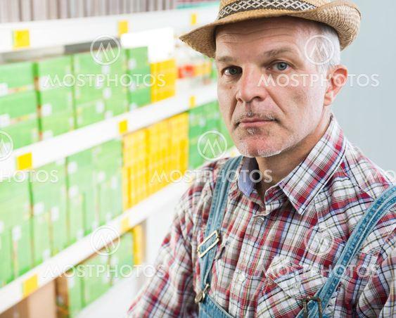 Confident farmer at supermarket