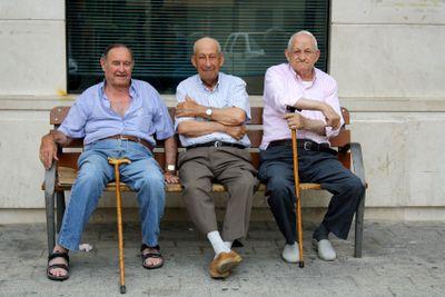 Elderly Spanish men sitting on bench