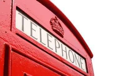 Close up of an old English red telephone box.