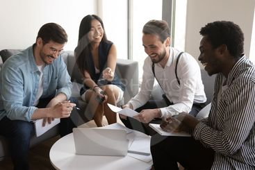 Happy diverse team people laughing working together at...