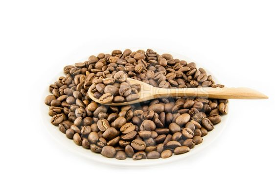 Cup full of coffee beans isolated