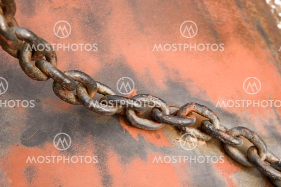 Old Chain on Rusty Metal
