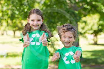 Happy siblings in green with thumbs up