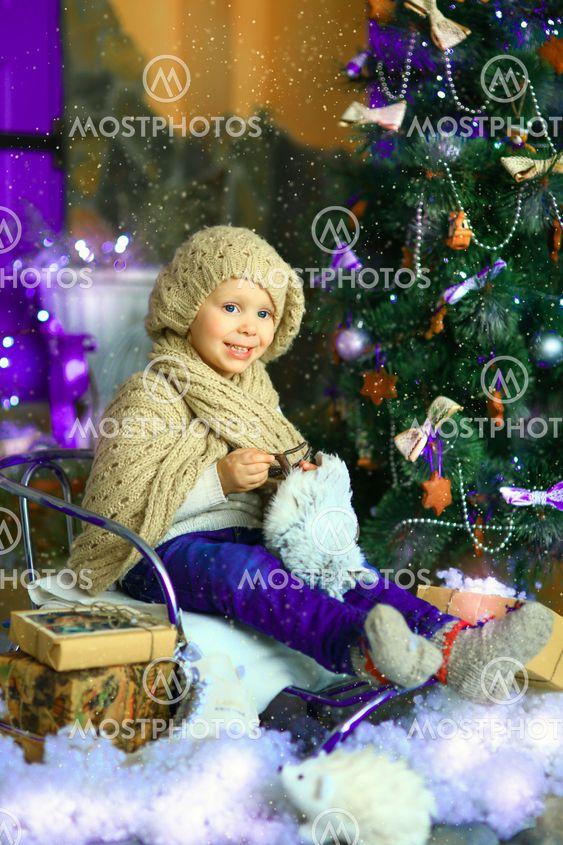 the girl near a Christmas fir-tree 5