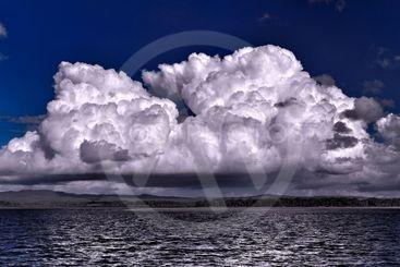 Magnificent Cumulus white cloud in blue sky. Australia.