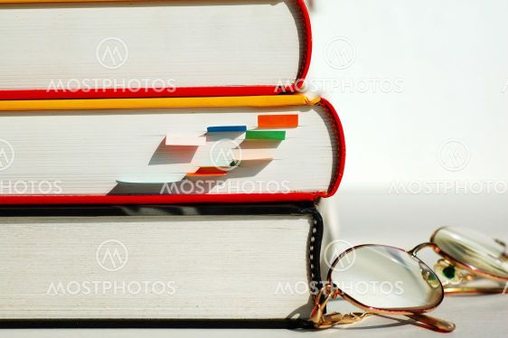Three books and glasses