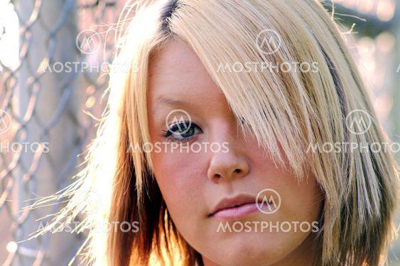 Closeup Serious Young Blond Woman