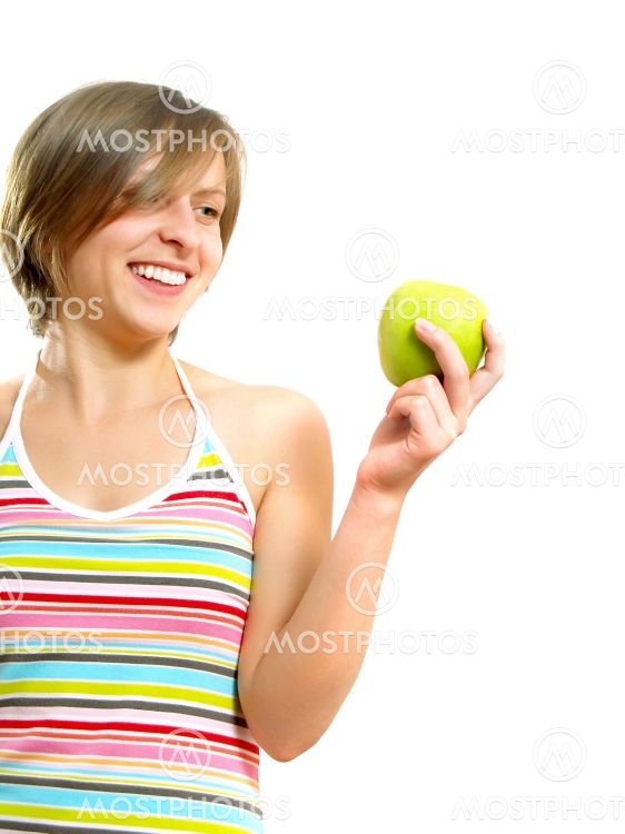 Beautiful girl with a green apple