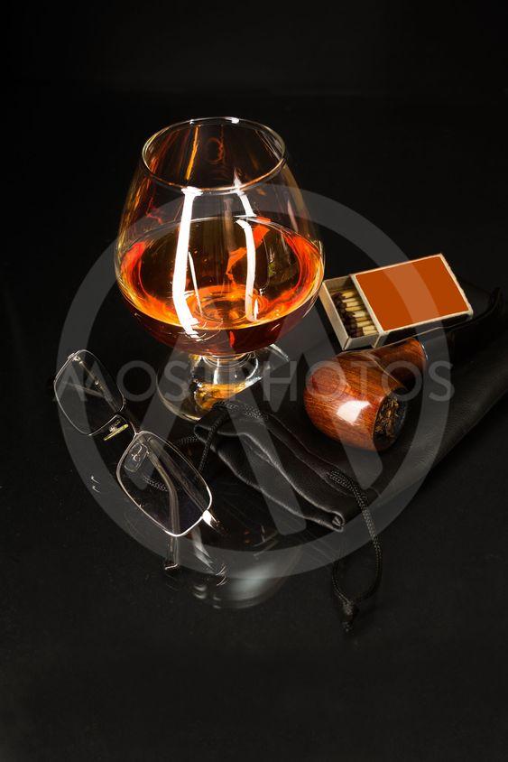Whiskey glass and smoking p