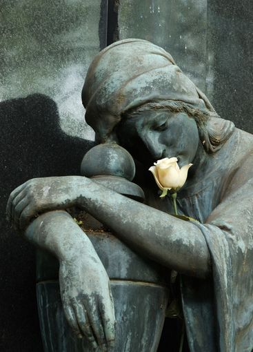 Statue with rose