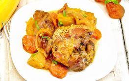 Chicken roast with pumpkin and carrots on wooden board