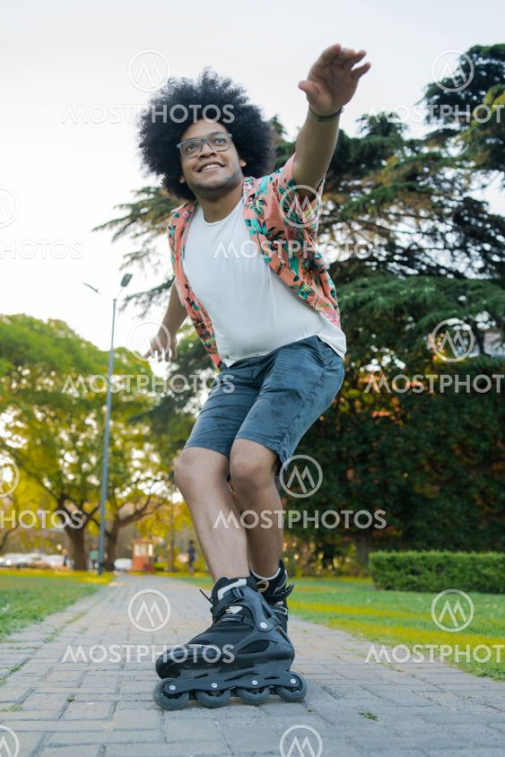 Latin man rollerskating outdoors.