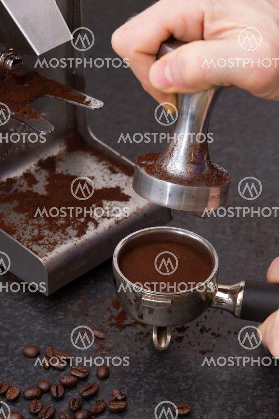 Preparing espresso beans.