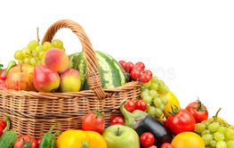 Large variety useful fruits and vegetables in basket...