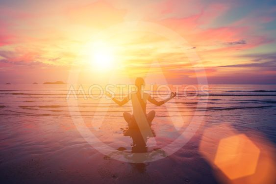 Sunset yoga on the beach, abstract photo about healthy...