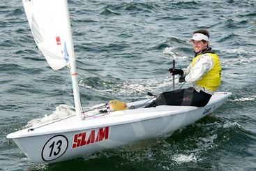 Children sailing racing dinghies up close. April 16,...