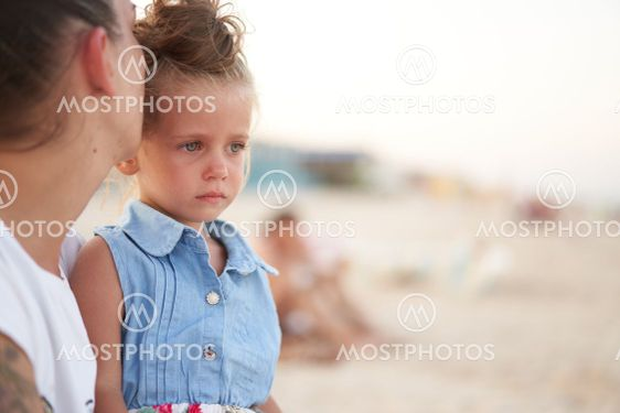 Little girl crying Mother daughter summer beach. Child...