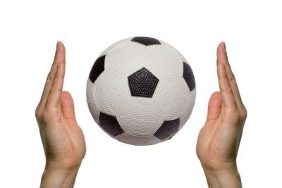 Soccer ball between two hands