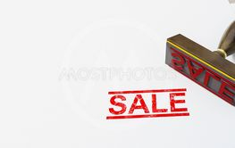 red stamp sale on white paper background