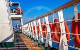 Orange lifesaver on the deck of a cruise ship