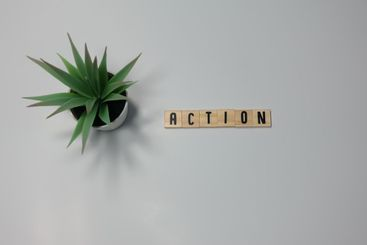 The word Action written in wooden letter tiles on a...