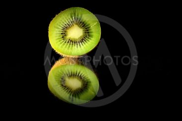 kiwi in the reflections on a pure black background