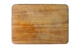 Old wooden cutting board with scratches on white...