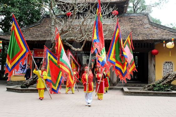 Group of people in traditional costume give gifts to the...