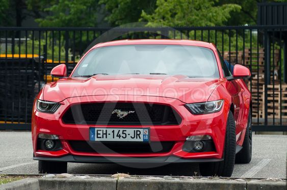 red Ford Mustang V8 GT front parked in the street