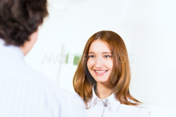 Attractive woman talking with a man