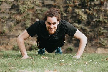 Close up of a young man training at the park over the...