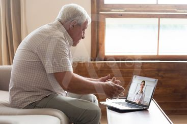 Elderly man make distant video call communicating with...