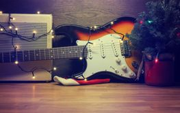 Old vintage electric guitar with Christmas lights
