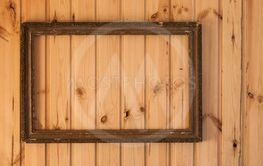 vintage photo frame on old wooden wall