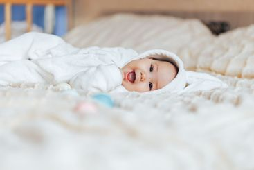 Cute smile happy little baby in white rabbit costume,...