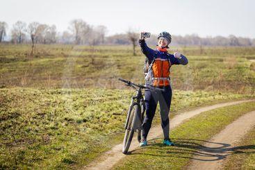 female cyclist makes selfie