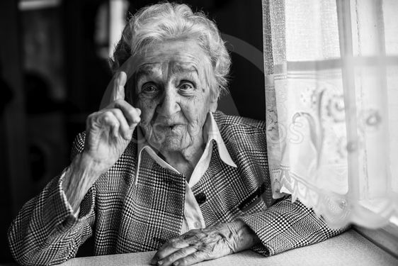 Elderly women gesticulating when speaking, sitting near...