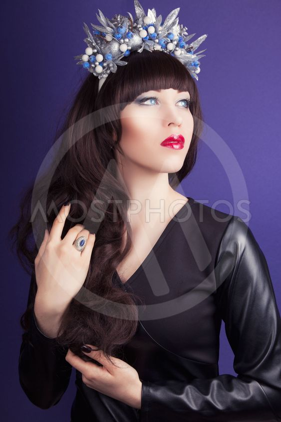 beautiful young woman wearing designer wreath and posing...