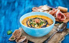 Pumpkin cream soup bowl, served with sesame,...