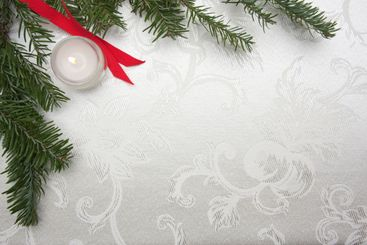 Silk Christmas Background with Candle and Pine Branches