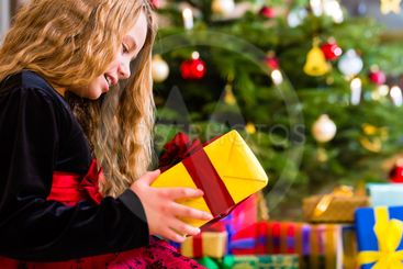 Girl opening present on Christmas day