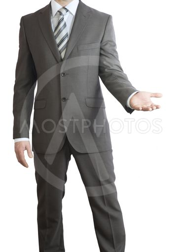 Man in suit holding his hand before him