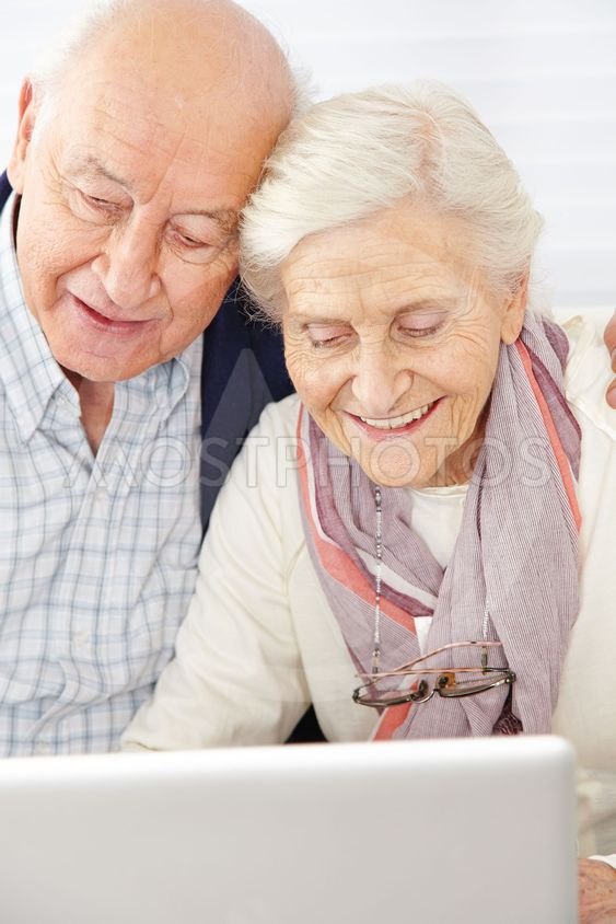 Senior couple using social media with computer