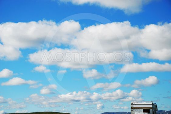 The sky with clouds and travel trailer