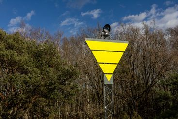 Yellow triangle maritime sign.