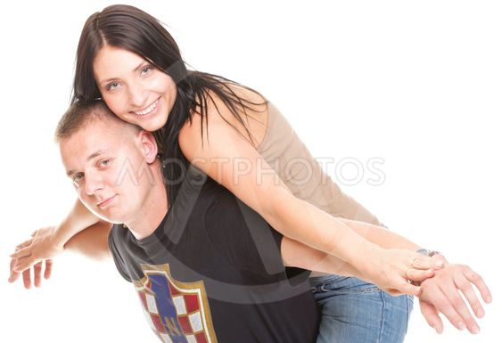 Portrait of a beautiful young happy smiling couple isolated
